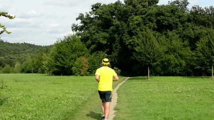 man sports - running - park (trees and grass) - cloudy