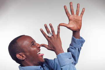 Young African boy with mocking gesture