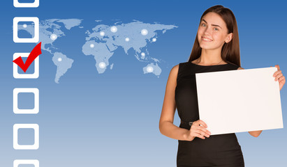 Businesswoman with checkboxes and world map