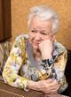 Portrait of old sad woman
