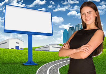Businesswoman with blank billboard