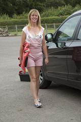 Female motorist carrying a car crawler