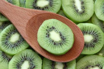 Kiwi slice in a wooden spoon