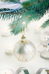 christmas ball hanging on fir tree