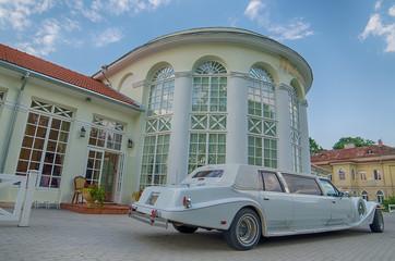 Vintage limousine next to castle in Raudondvaris, Lithuania