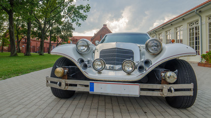Vintage limousine next to castle in Raudondvaris, Lithuania