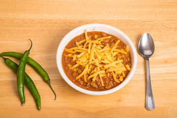 Bowl of Chili with Three Cayenne Peppers