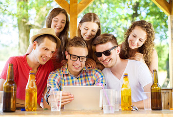 Friends drinking and using tablet