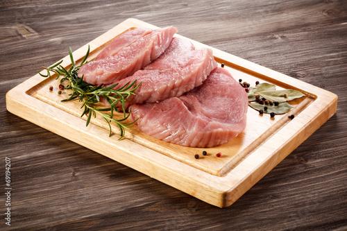 canvas print picture Fresh raw pork on cutting board