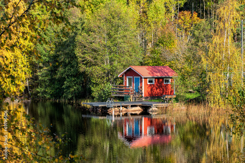 Traditional Swedish summer cottage during autumn - 69194606