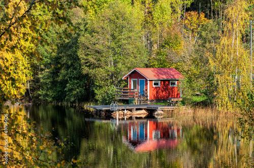 Leinwandbild Motiv Traditional Swedish summer cottage during autumn