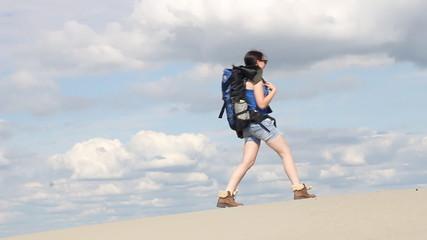 girl hiker walking in desert
