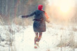 canvas print picture - happy girl winter snow runs