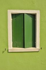 Green window in Burano, Venice, Italy