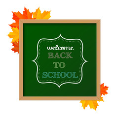 "Chalkboard sign ""back to school"" with maple leaves"