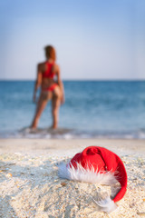 sexy woman in santa hat on sea