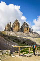 Young woman hiker with view of Tre Cime di Lavaredo