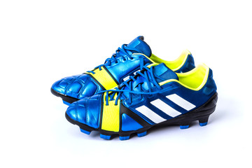 blue soccer shoes on white background