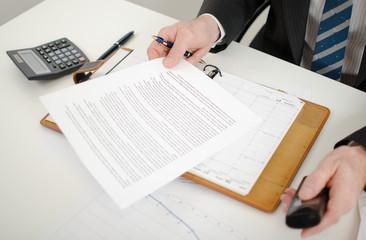 Businessman reading a document