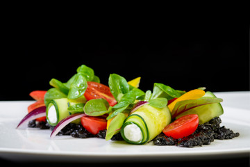 Original Greek salad on black background