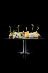 Cheese plate on black background