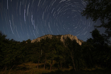Star trails around north star in Transylvania landscape