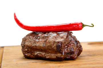 steak with pepper on wood plate