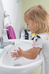 Little girl washing hands