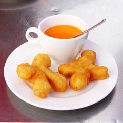 Deep-fried dough sticks and  Ceylon's tea.