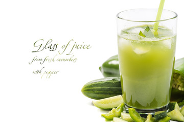 Glass of juice from fresh cucumbers with pepper. Background