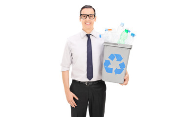 Man holding a recycle bin full of plastic bottles