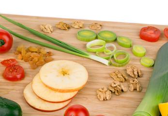 Vegetables on wooden platter.