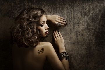 Woman Tattoo on back shoulder, sexy girl beauty fashion portrait