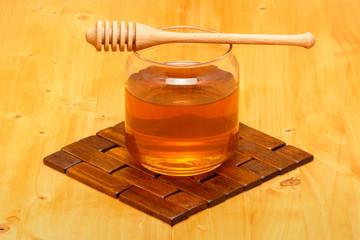 Honey in jar with dipper