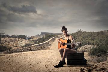 young beautiful girl playing guitar