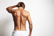 Leinwanddruck Bild - perfect fit man from the back in white towel