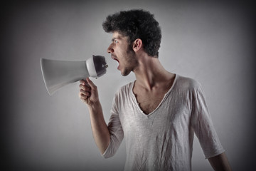 young man yelling with a megaphone