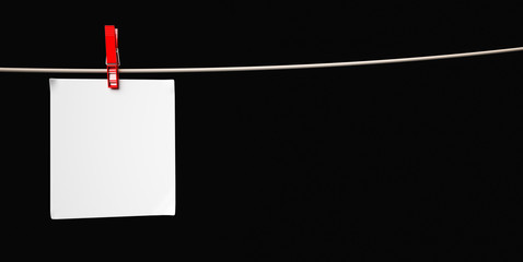 Paper card and peg hanging on the rope