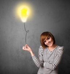 Woman holding a lightbulb balloon