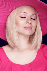 Beauty. Fashionable pretty blond woman with makeup wearing in pi