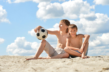 Two brothers with soccer ball