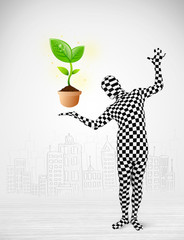 man in full body suit with eco plant