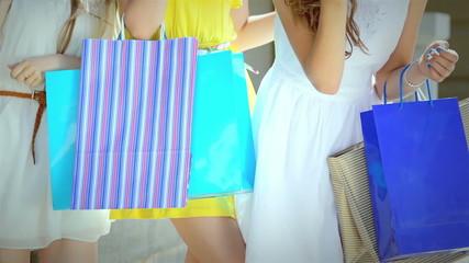 Three young girl shopaholic do sunny kiss