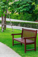 empty wood armchair in garden