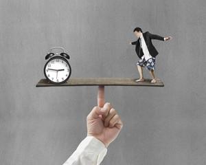 man standing on finger seesaw vs clock