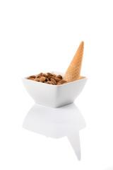 Almonds with ice cream cone in white bowl