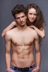 Shirtless young couple embracing