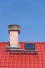 Dach und Schornstein