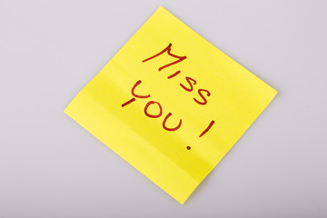 Yellow note paper miss you message