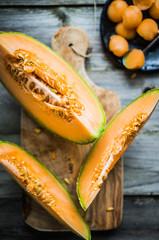 Sliced melon on wooden background